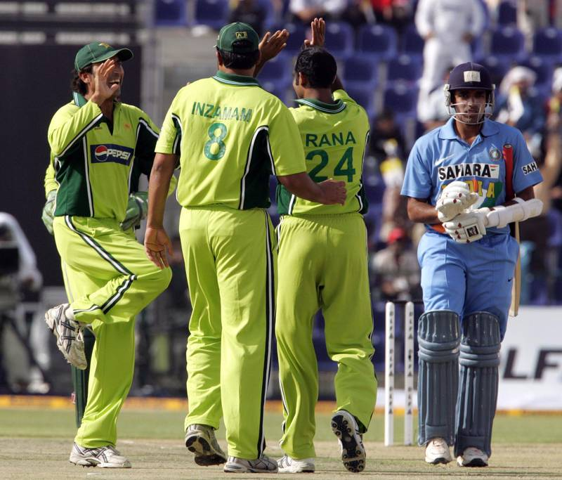 Pakistani bowler Rana Naved-ul-Hasan (2nd R) celebrates with captain Inzamam-ul-Haq and another teammate the Indian captain Rahul Dravid's (R) run out during the first of two day-night Cricket matches between India and Pakistan at the Zayad Cricket Stadium in Abu Dhabi, 18 April 2006. Proceeds from today's match will be donated to the survivors of the massive earthquake that hit Kashmir last October killing more than 73,000 people in Pakistan and 1,300 in India, while revenues from the second game tomorrow will be shared by the Indian and Pakistan cricket boards. AFP Photo/RABIH MOGHRABI / AFP PHOTO / RABIH MOGHRABI