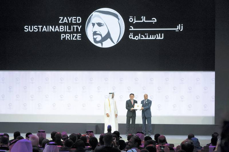ABU DHABI, UNITED ARAB EMIRATES - January 14, 2019: HH Sheikh Mohamed bin Zayed Al Nahyan, Crown Prince of Abu Dhabi and Deputy Supreme Commander of the UAE Armed Forces (L) and HE Mohamed Ould Abdel Aziz, President of Mauritania (R), present an award to a representative from 'ECOSOFTT', winners of the Zayed Sustainability Prize for Water  ( Hamed Al Mansoori / Ministry of Presidential Affairs ) ---
