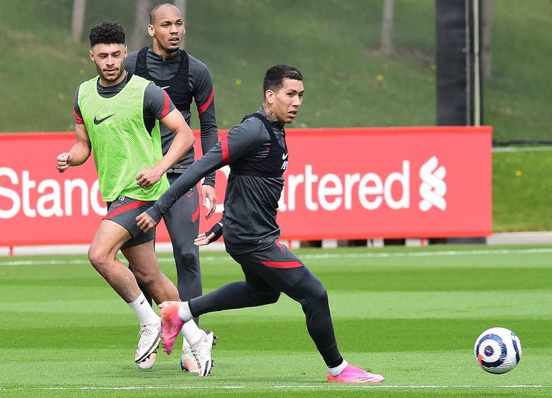 KIRKBY, ENGLAND - APRIL 28:(THE SUN OIUT. THE SUN ON SUNDAY OUT) Fabinho, Alex Oxlade-Chamberlain and Roberto Firmino of Liverpoolduring a training session at AXA Training Centre on April 28, 2021 in Kirkby, England. (Photo by John Powell/Liverpool FC via Getty Images)
