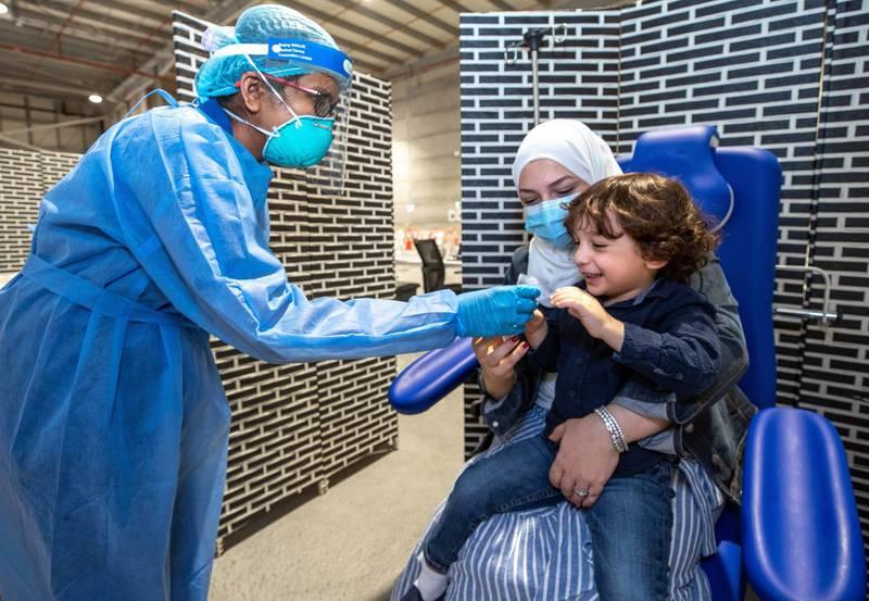 Abu Dhabi, United Arab Emirates, March 18, 2021.  Omar Al Mulla, three years old, gets saliva tested at the Biogenix lab at G42 in Masdar City.Victor Besa/The NationalSection:  NAReporter:  Shireena Al Nowais