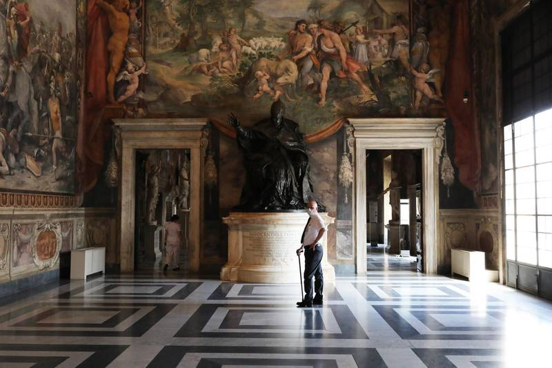 ROME, ITALY - MAY 19: A museum employee wearing a face mask stands in one of the rooms of the Capitoline Museums on the first day of opening after more than two months of lockdown on May 19, 2020 in Rome, Italy. Museums, restaurants, bars, cafes, hairdressers and other shops have reopened, subject to social distancing measures, after more than two months of a nationwide lockdown meant to curb the spread of Covid-19. Churches are starting to celebrate Mass again, but there will be strict social distancing and worshippers must wear face masks. And citizens will no longer be required to justify their movements with self-certification. (Photo by Marco Di Lauro/Getty Images)