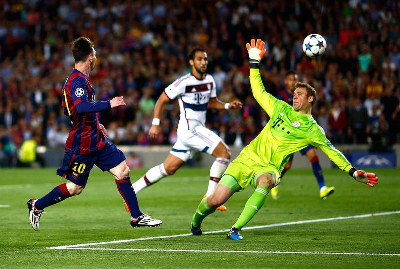 BARCELONA, SPAIN - MAY 06:  Lionel Messi of Barcelona scores his second goal against Manuel Neuer of Bayern during the first leg of UEFA Champions League semifinal match between FC Barcelona and FC Bayern Muenchen at Camp Nou on May 6, 2015 in Barcelona, Spain.  (Photo by Vladimir Rys Photography/Getty Images)