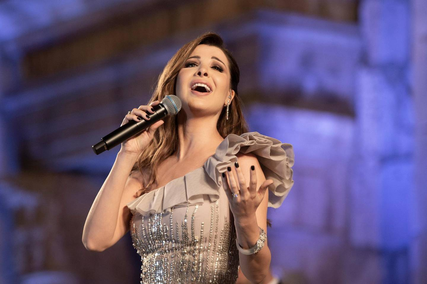 epa07730336 Lebanese singer Nancy Ajram performs during the 2019 Jerash Festival of Culture and Arts at the Jerash archeological site, Jerash, some 46 km North of Amman, Jordan, 20 July 2019. The Jerash festival takes part from 18 to 27 July 2019.  EPA/ANDRE PAIN