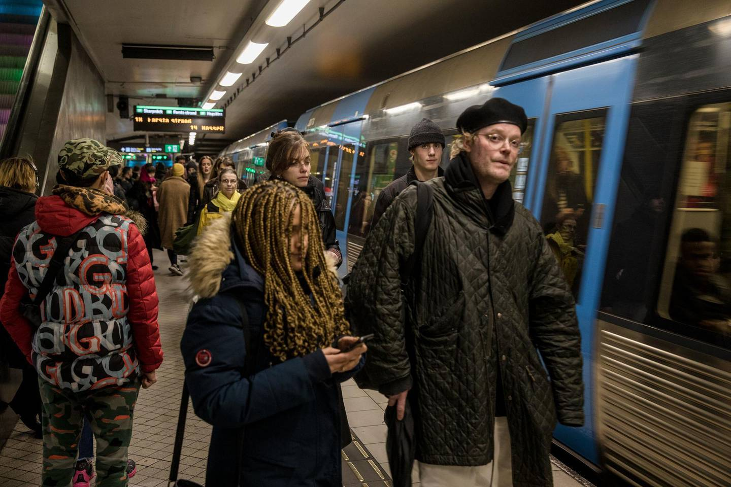 STOCKHOLM- SWEDEN - DECEMBER 4: Passengers are waiting on the platform at the T-centralen station to board the metro on December 4, 2020 in Stockholm, Sweden. Despite government guidelines regarding social distancing and avoiding large crowds, the metro stations are full of passengers crowded on the platforms. Over 7,000 people have died of COVID-19 in Sweden, giving the country of 10.2 million one of Europe's highest death rates per capita. (Photo by Jonas Gratzer/Getty Images)
