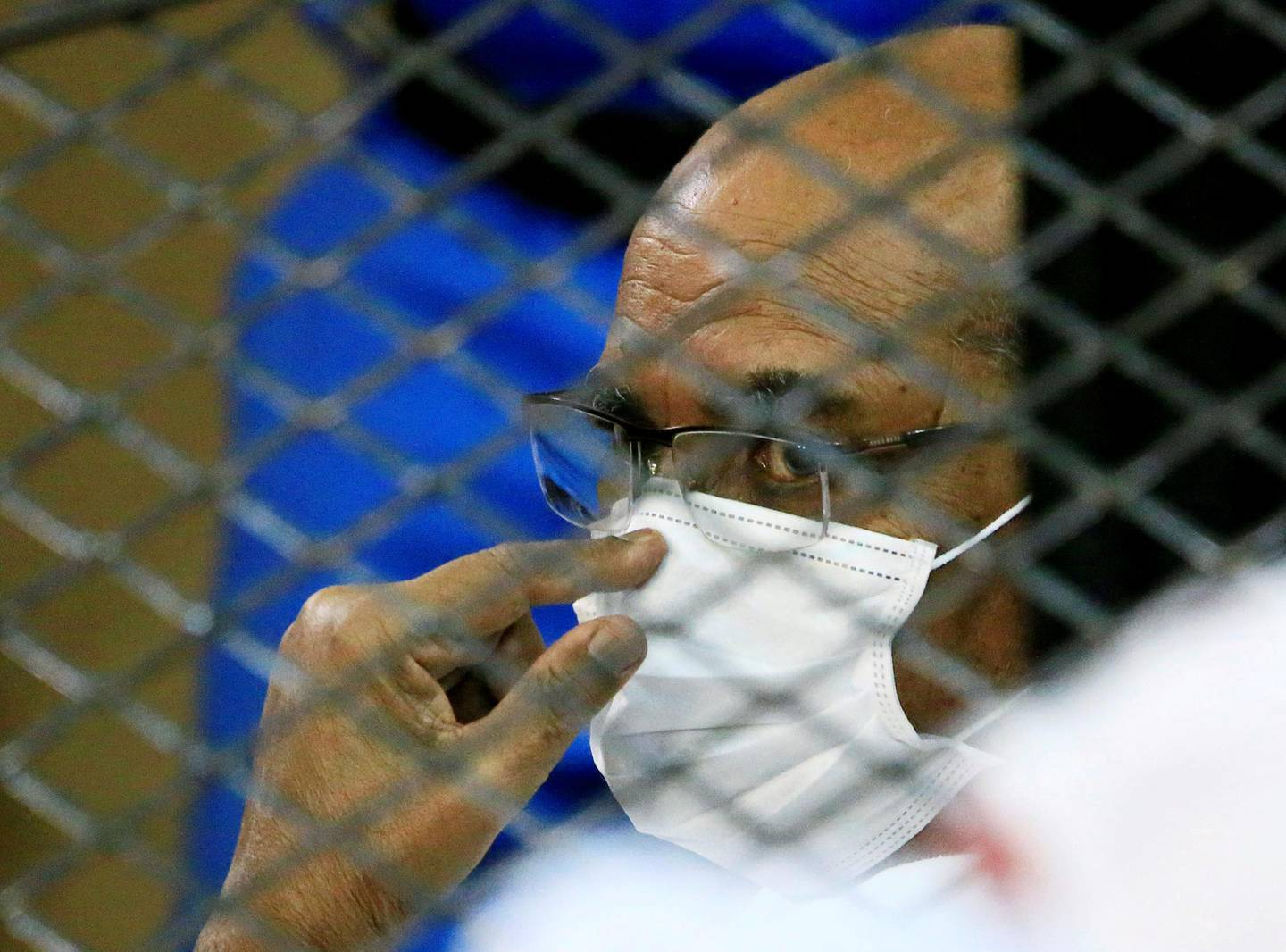 FILE PHOTO: Sudan's ousted president, Omar al-Bashir, is seen inside the defendant's cage during his and some of his former allies' trial over the 1989 military coup that brought him to power, at a courthouse in Khartoum, Sudan, September 15, 2020. REUTERS/Mohamed Nureldin Abdallah/File Photo