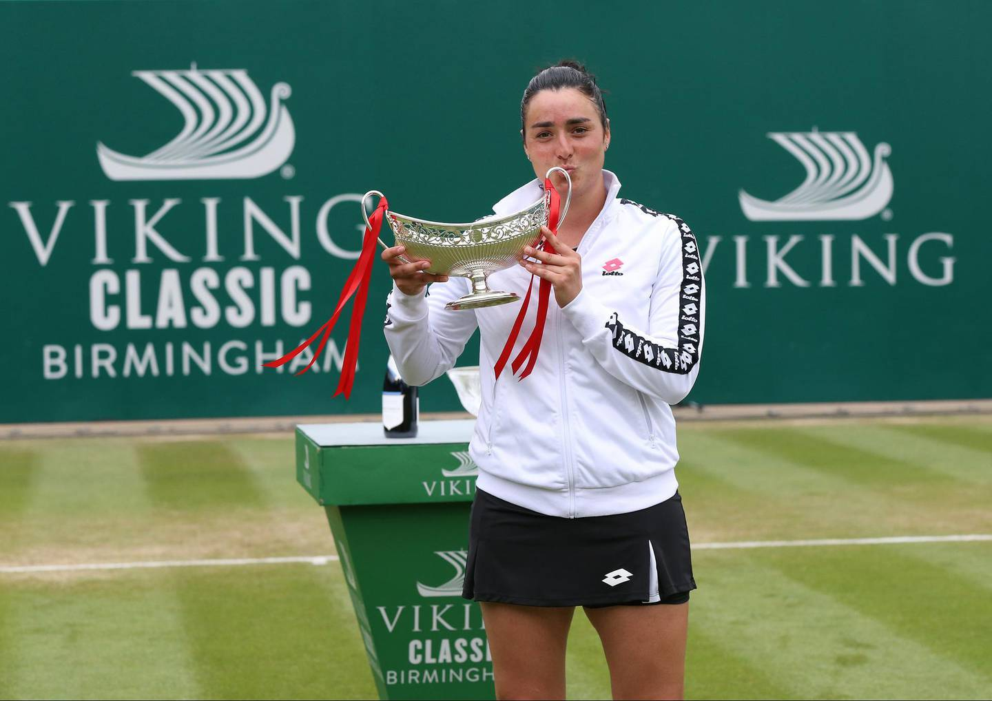 BIRMINGHAM, ENGLAND - JUNE 20: Ons Jabeur of Tunisia celebrates with the trophy after her victory against Daria Kasatkina of Russia in the Womens Singles Final during the Viking Classic Birmingham at Edgbaston Priory Club on June 20, 2021 in Birmingham, England. (Photo by Barrington Coombs/Getty Images for LTA)