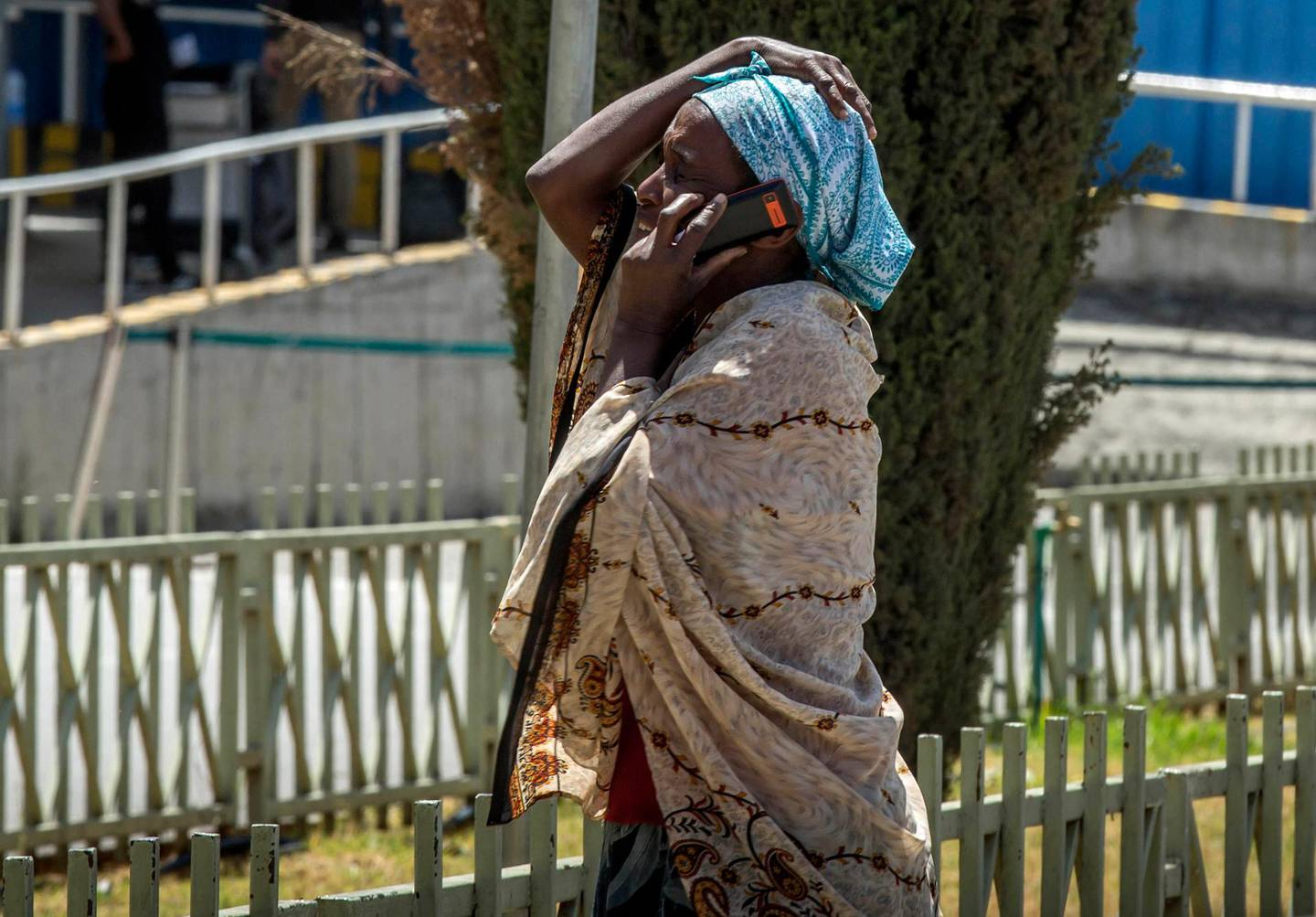 A family member of a victim involved in a plane crash talks on a mobile phone at Addis Ababa international airport Sunday, March 10, 2019. An Ethiopian Airlines flight crashed shortly after takeoff from Ethiopia's capital on Sunday morning, killing all 157 people thought to be on board, the airline and state broadcaster said, as anxious families rushed to airports in Addis Ababa and the destination, Nairobi. (AP Photo/Mulugeta Ayene)