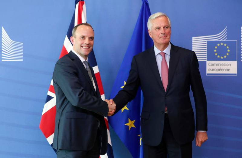 Britain's newly appointed chief Brexit negotiator Dominic Raab, left, is welcomed by EU's chief Brexit negotiator Michel Barnier ahead of a meeting at the European Commission in Brussels, Thursday, July 19, 2018. Britain's chief Brexit negotiator David Davis resigned less than two weeks ago and his successor Raab met his EU counterpart Michel Barnier for the first time late Thursday.(Stephanie Lecocq/Pool Photo via AP)