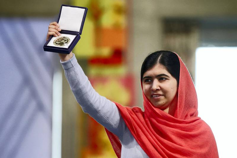 Nobel Peace Prize laureate Malala Yousafzai displays her medal during the Nobel Peace Prize awards ceremony at the City Hall in Oslo, Norway, on December 10, 2014. 17-year-old Pakistani girls' education activist Malala Yousafzai known as Malala shares the 2014 peace prize with the Indian campaigner Kailash Satyarthi, 60, who has fought for 35 years to free thousands of children from virtual slave labour.      AFP PHOTO /POOL/CORNELIUS POPPE / AFP PHOTO / POOL / CORNELIUS POPPE