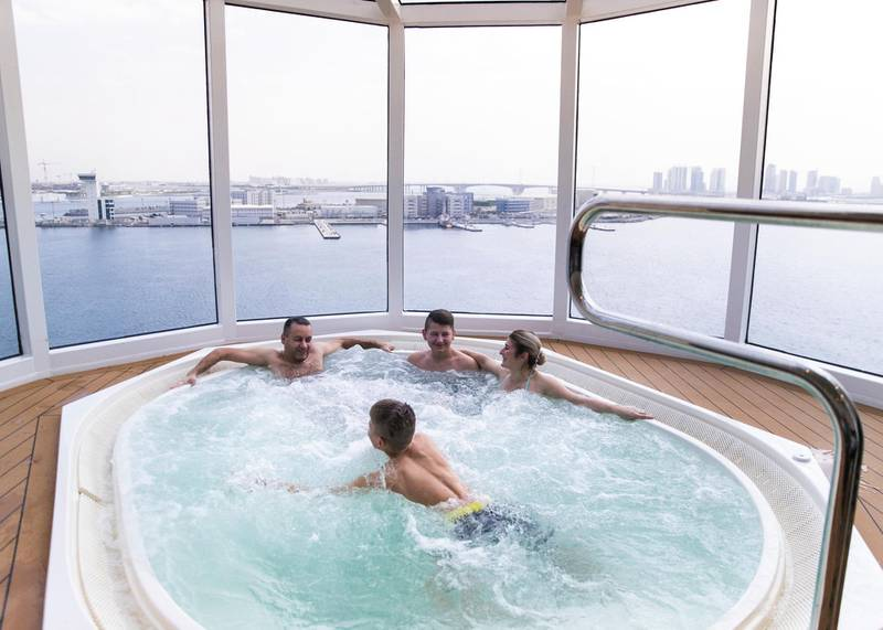 ABU DHABI, UNITED ARAB EMIRATES. 8 DECEMBER 2019. A family in a jacuzzi overlooking Abu Dhabi and the Louvre from MSC Bellissima at Abu Dhabi Cruise Terminal.(Photo: Reem Mohammed/The National)Reporter:Section: