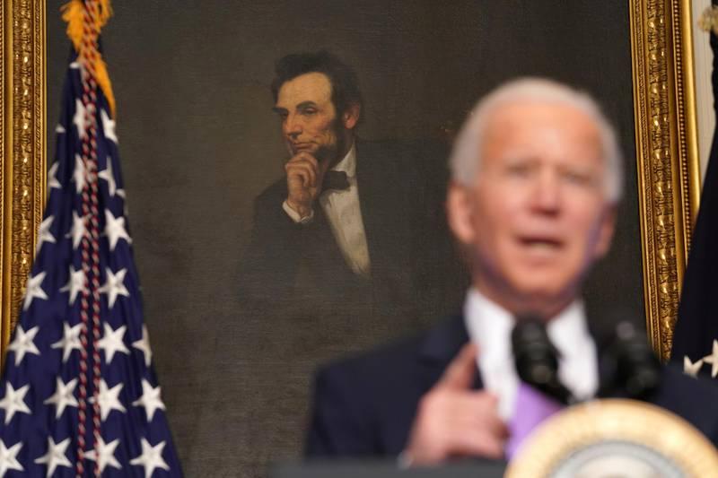 U.S. President Joe Biden speaks about the fight to contain the coronavirus disease (COVID-19) pandemic, in front of a portrait of Abraham Lincoln at the White House in Washington, U.S. January 26, 2021. REUTERS/Kevin Lamarque