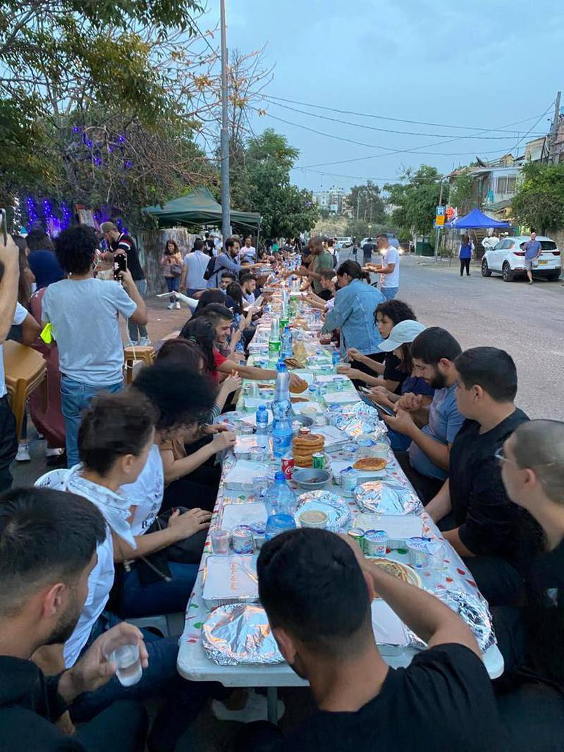Members of families in Sheikh Jarrah neighbourhood, East Jerusalem, break the Ramadan fast with meals catered by different households  in solidarity with fellow neighbours facing eviction from their homes. Courtsey Asala Abu Hasna