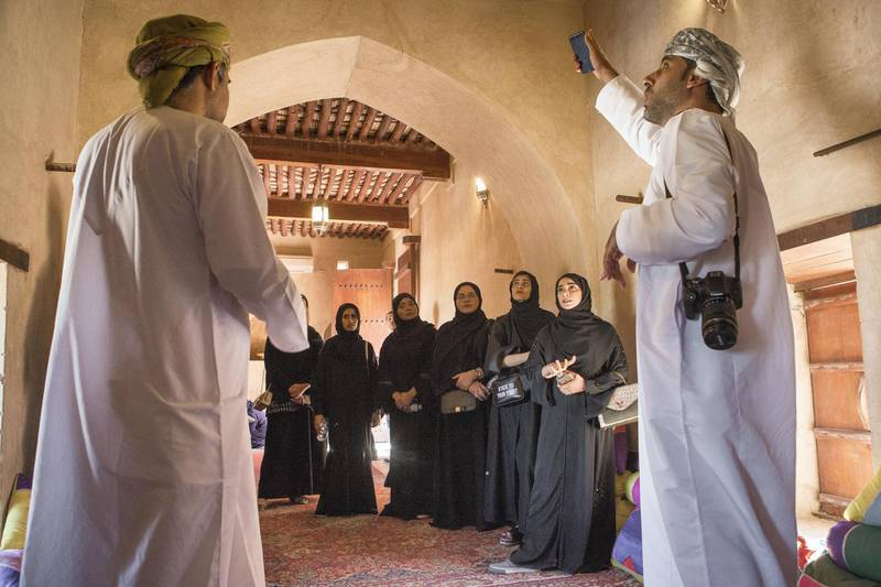 A group of female Omani diploma students practice tour guiding with Bader Thuhli (right), a professor of tour guiding at the Oman Tourism College, the only college in the Sultanate of Oman specializes Tourism & Hospitality.