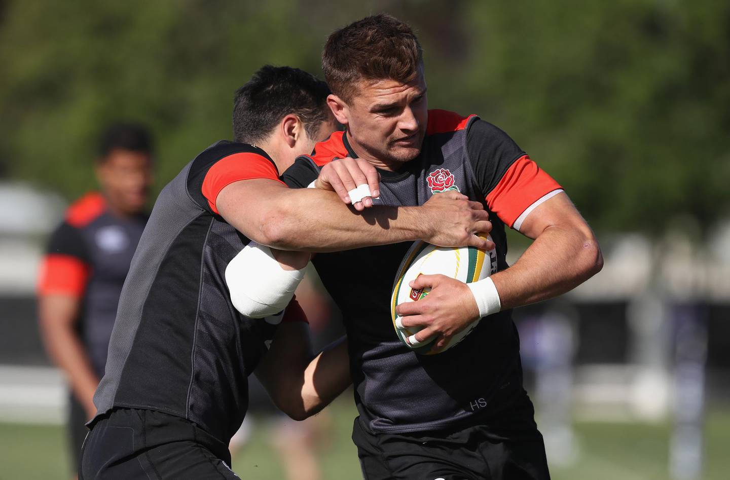 DURBAN, SOUTH AFRICA - JUNE 05:  Henry Slade is tackled by Alex Lozowski during the England training session held at Kings Park Stadium on June 5, 2018 in Durban, South Africa.  (Photo by David Rogers/Getty Images)