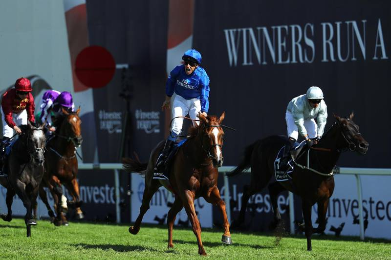 EPSOM, ENGLAND - JUNE 02:  William Buick ridding Masar celebrates crossing the line and winning the Investec Derby race on Derby Day at Epsom Downs on June 2, 2018 in Epsom, England.  (Photo by Warren Little/Getty Images)