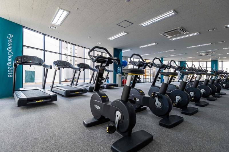 This view shows the fitness centre at the athletes' Olympic Village on January 25, 2018 in Gangneung before the start of the 2018 Pyeongchang Winter Olympic Games. / AFP PHOTO / François-Xavier MARIT