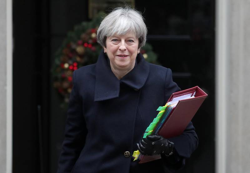 Britain's Prime Minister Theresa May leaves 10 Downing Street in central London on December 6, 2017, ahead of the weekly Prime Minister's Questions (PMQs) session in the House of Commons. Northern Ireland's Democratic Unionist Party accused Britain on Tuesday of keeping it in the dark over a proposed Brexit deal on the Irish border but said it would examine the text after blocking an agreement in Brussels. / AFP PHOTO / Daniel LEAL-OLIVAS