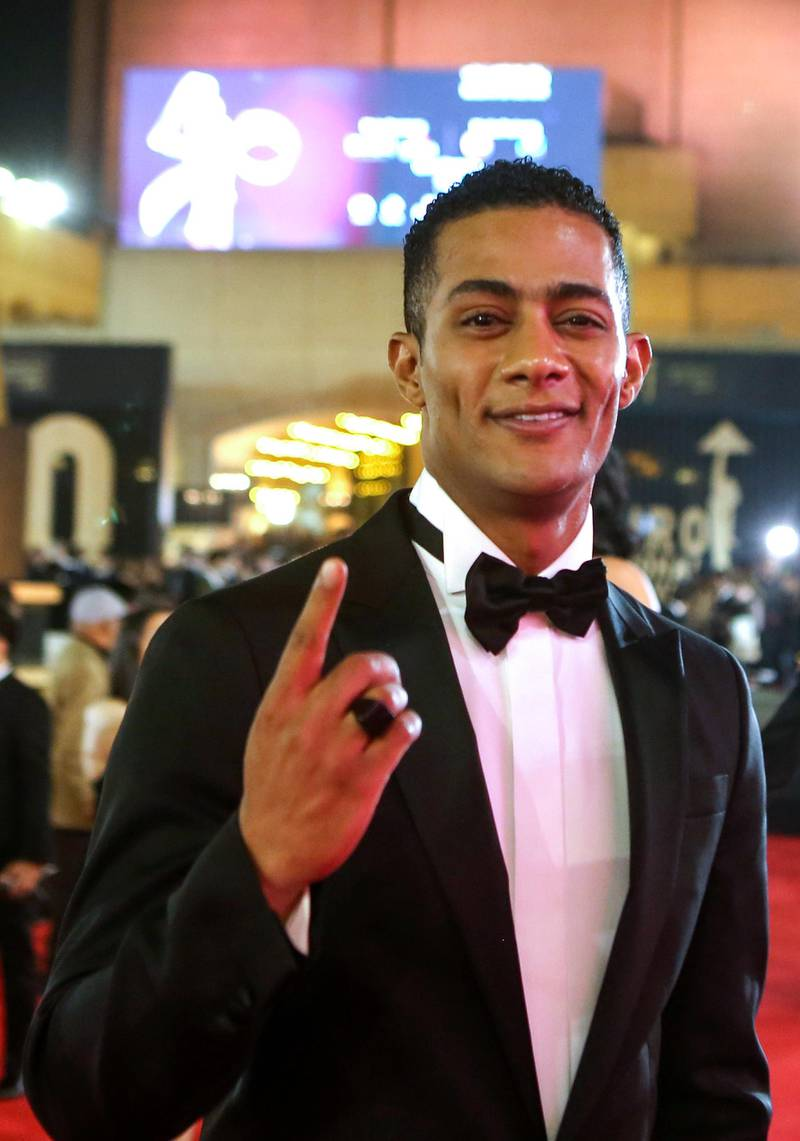 """Egyptian actor Mohamed Ramadan poses on the red carpet of the 40th edition of the Cairo International Film Festival (CIFF) at the Cairo Opera House in the Egyptian capital on November 20, 2018. (Photo by Patrick BAZ / Cairo International Film Festival / AFP) / RESTRICTED TO EDITORIAL USE - MANDATORY CREDIT """"AFP PHOTO / CAIRO INTERNATIONAL FILM FESTIVAL"""" - NO MARKETING - NO ADVERTISING CAMPAIGNS - DISTRIBUTED AS A SERVICE TO CLIENTS"""