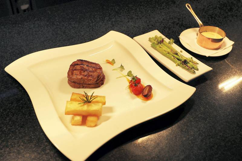 ABU DHABI , UNITED ARAB EMIRATES , APRIL 17   – 2018 :- Grill Wagyu Steak with carrot puree and sauce dish made by Daniel Vicente , Chef at the Capital Grill restaurant at Dusit Thani hotel in Abu Dhabi. ( Pawan Singh / The National ) For Weekend. Story by Melinda Healy