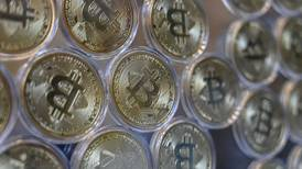 Bitcoin edges above $50,000 for first time since mid-May