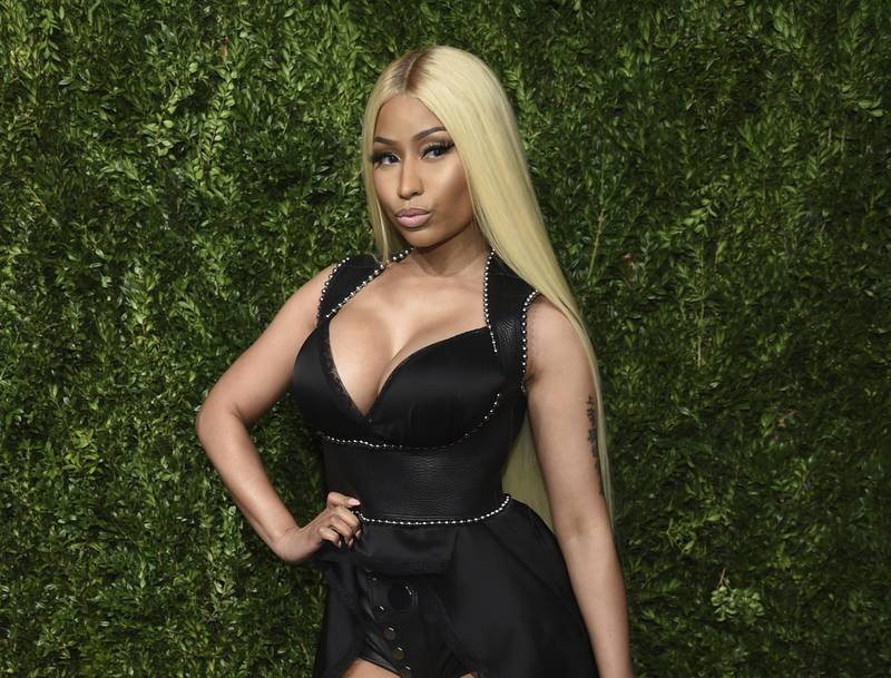 """FILE - This Nov. 6, 2017 file photo shows Nicki Minaj at the 14th Annual CFDA Vogue Fashion Fund Gala in New York. The chart-topping rapper announced Thursday, Sept. 5, 2019, on Twitter that she """"decided to retire & have my family.""""  In the tweet, Minaj she took a jab at her critics and asked her fans to """"keep reppin me, do it til da death of me."""" In July, Minaj announced she was pulling out a show in Saudi Arabia to show support women's rights, gay rights and freedom of expression. She also canceled her appearance at the BET Experience Concert earlier this year. (Photo by Evan Agostini/Invision/AP, File)"""