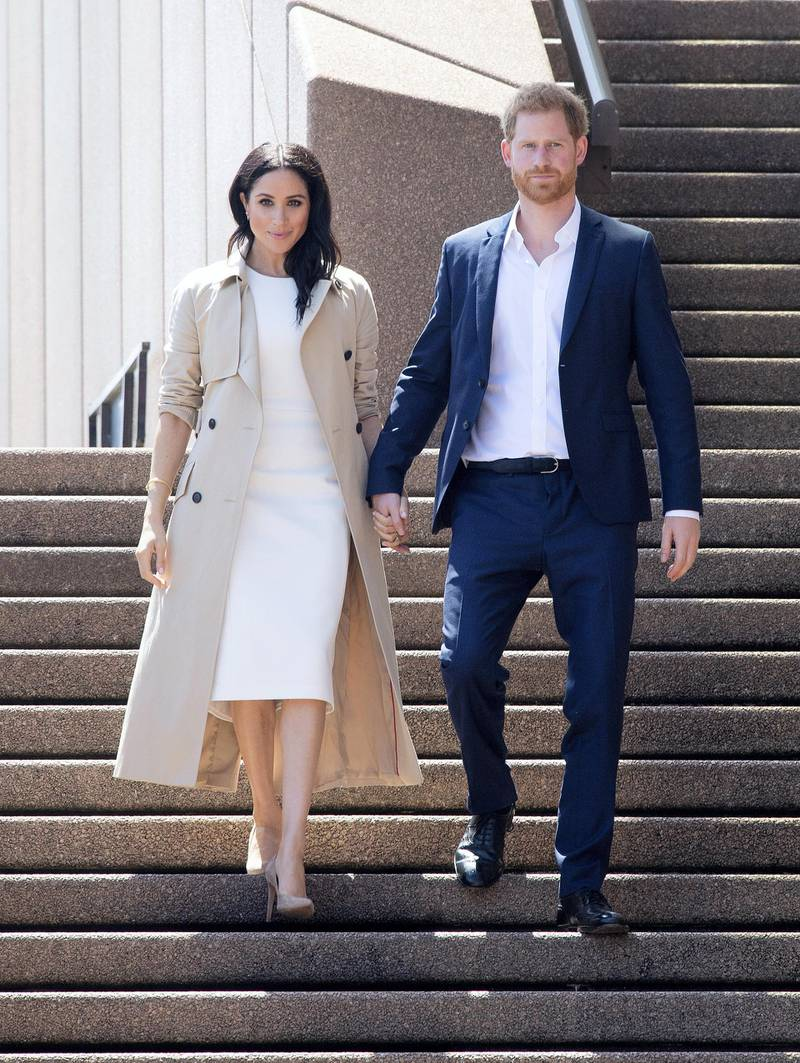 SYDNEY, AUSTRALIA - OCTOBER 16: Prince Harry, Duke of Sussex and Meghan, Duchess of Sussex meet and greet the public at the Sydney Opera House on October 16, 2018 in Sydney, Australia. The Duke and Duchess of Sussex are on their official 16-day Autumn tour visiting cities in Australia, Fiji, Tonga and New Zealand. (Photo by Paul Edwards - Pool/Getty Images)