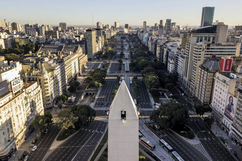 BUENOS AIRES, ARGENTINA - MARCH 20: Aerial view of a nearly empty 9 de Julio Avenue on the first day of total quarantine on March 20, 2020 in Buenos Aires, Argentina. President Alberto Fernandez declared a national quarantine until March 31st to reduce the circulation of the COVID-19 outbreak. Only those who work in the health system, production and commercialization of food, press and other essential services are authorized to circulate. (Photo by Getty Images/Getty Images)