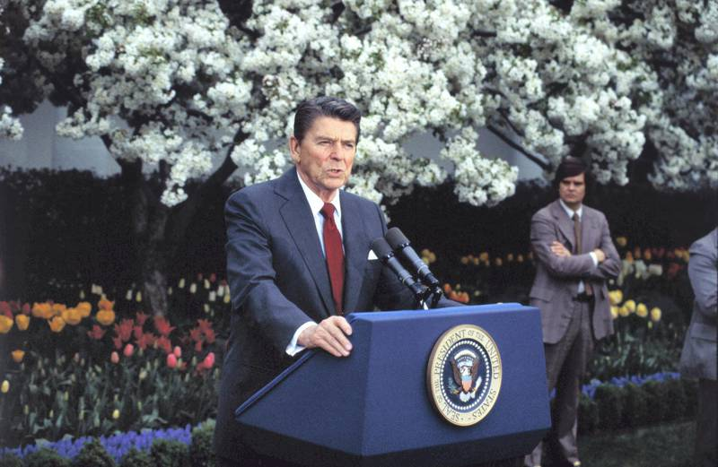 """(Original Caption) Washington: President Reagan in a meeting with reporters in the Rose Garden of the White House, says he is """"prepared to go the extra mile"""" in reaching an acceptable compromise with Congress on the 1983 budget."""
