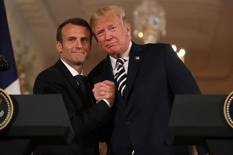 WASHINGTON, DC - APRIL 24:  French President Emmanuel Macron (L) and U.S. President Donald Trump embrace at the completion of a joint press conference in the East Room of the White House April 24, 2018 in Washington, DC. Macron and Trump met throughout the day to discuss a range of bilateral issues as Trump holds his first official state visit with the French president.  (Photo by Chip Somodevilla/Getty Images)