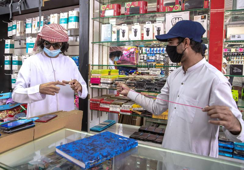 Abu Dhabi, United Arab Emirates, April 23, 2020.  A mobile phone customer at the  Mussafah 32 area during the Coronavirus pandemic.Victor Besa / The NationalSection:  NAFor: stock images and standalone