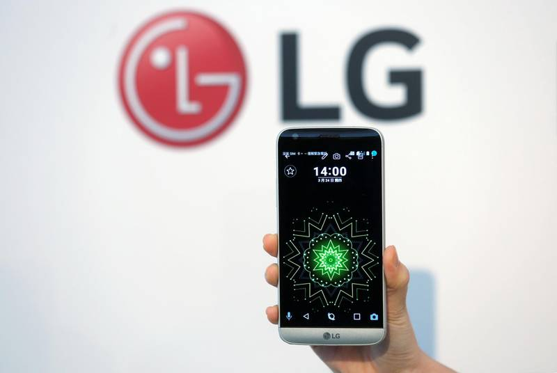 A model poses for photographs with LG Electronics' new smartphone G5 during its launch event in Taipei, Taiwan March 24, 2016. REUTERS/Tyrone Siu/File Photo