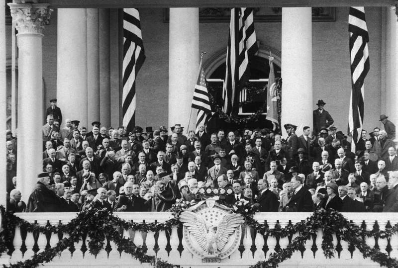 4th March 1924:  American president Calvin Coolidge (1872 - 1933) takes the oath of office at his Inauguration ceremony, Washington, DC. William Howard Taft, Supreme Court Justice and former President, presides over the ceremony.  (Photo by New York Times Co./Getty Images)