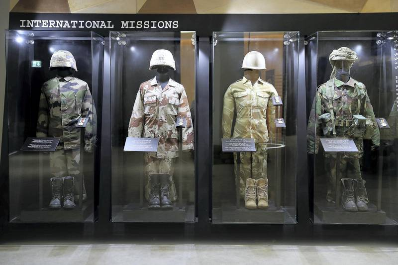DUBAI , UNITED ARAB EMIRATES , JAN 25 – 2018 :- Left to Right – Kosovo peacekeeping mission uniform, Restore Hope in Somalia mission uniform , Liberation of Kuwait operation uniform and Lebanon Peacekeeping mission uniform on display at the UAE Armed Forces Exhibition held at Etihad Museum in Dubai. (Pawan Singh / The National) For Arts & Life. Story by John Dennehy
