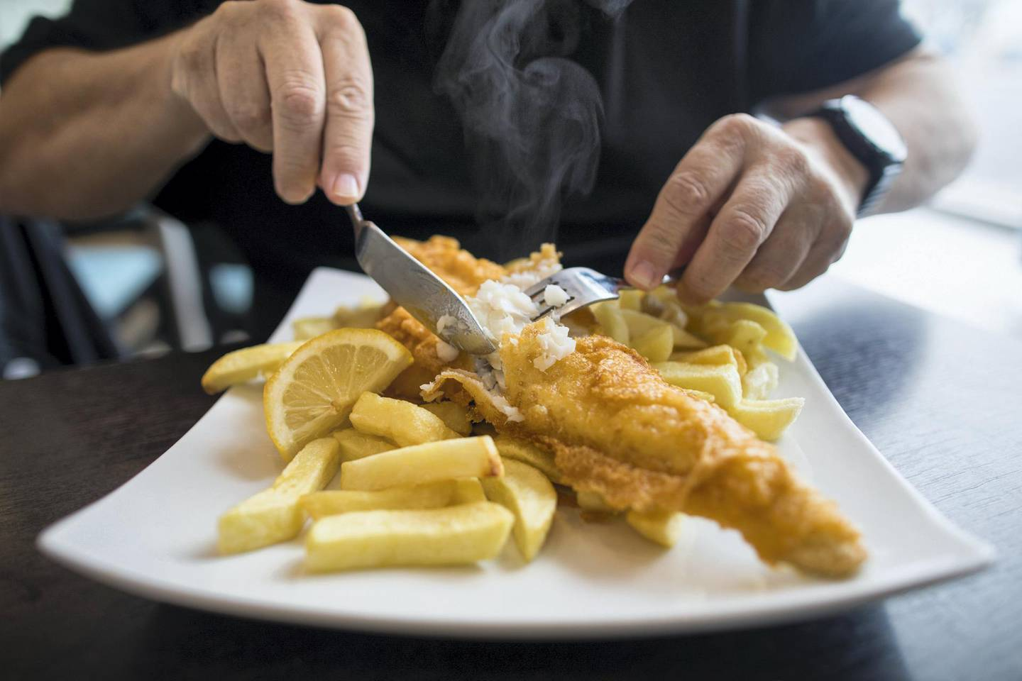 A customer cuts a cod on a plate of fish and chips at a restaurant in Deal, U.K., on Thursday, Oct. 15, 2020. Germany put pressure on France to back down on its demands over fishing, one of the biggest obstacles to a post-Brexit trade deal with the U.K., as Boris Johnson warned he is disappointed about the progress of the negotiations. Photographer: Chris Ratcliffe/Bloomberg via Getty Images