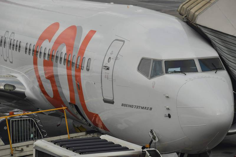 A Boeing 737 MAX aircraft operated by low-cost airline Gol is seen on the tarmac at Guarulhos International Airport, near Sao Paulo on December 9, 2020, as the 737 MAX returns into use more than 20 months after it was grounded following two deadly crashes. / AFP / NELSON ALMEIDA