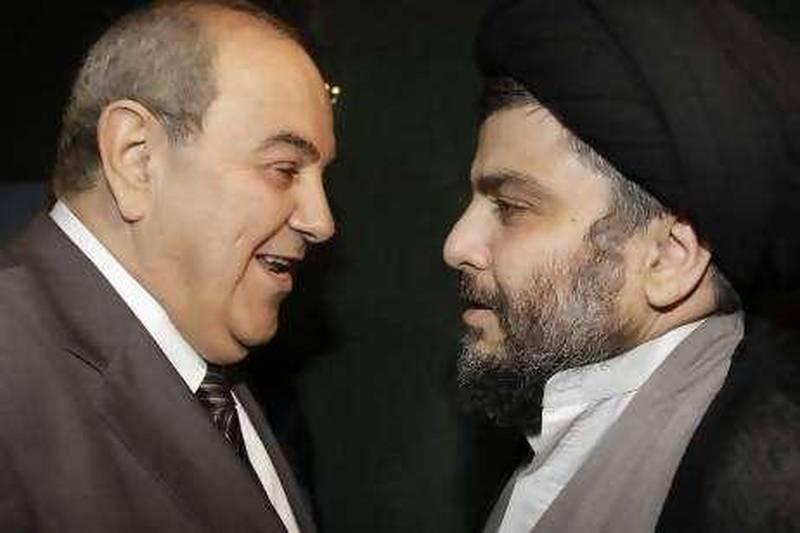 Iraqi Shiite cleric Moqtada al-Sadr welcomes former Iraq's Prime Minister Iyad Allawi (L) before a meeting in Damascus July 19, 2010. REUTERS/Khaled al-Hariri   (SYRIA - Tags: POLITICS) *** Local Caption ***  SYR07_SYRIA-_0719_11.JPG