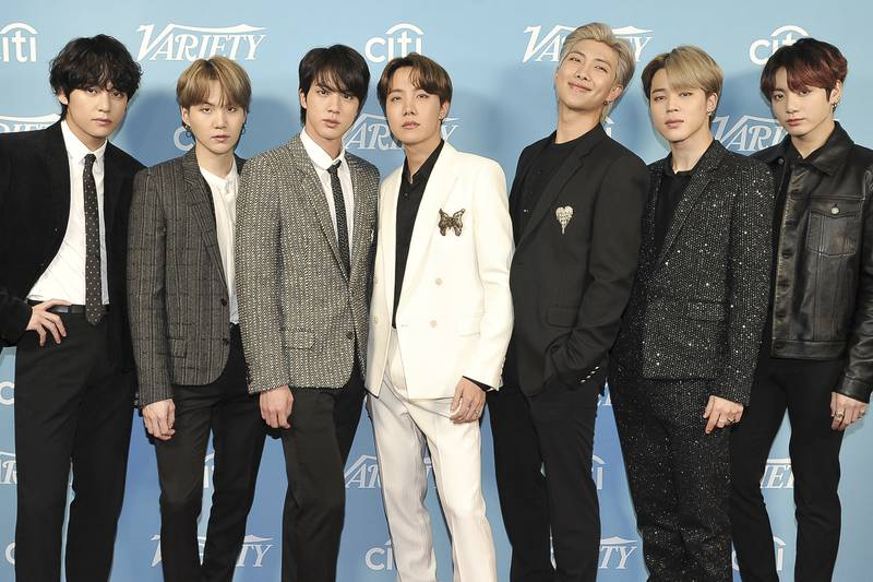 """FILE - Korean pop band BTS attends the 2019 Variety's Hitmakers Brunch in West Hollywood, Calif., on Dec. 7, 2019. """"Dynamite,"""" the group's first all-English song, debuted at No. 1 on the U.S. music charts this week, making BTS first Korean pop act to top the chart. (Photo by Richard Shotwell/Invision/AP, File)"""