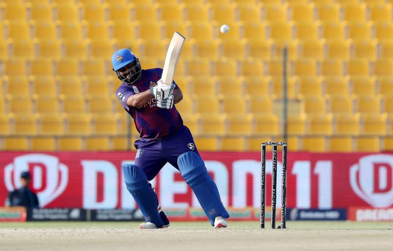 ABU DHABI , UNITED ARAB EMIRATES , Nov 19 – 2019 :- Mohammad Shahzad of Deccan Gladiators playing a shot during the Abu Dhabi T10 Cricket match between Qalanders vs Deccan Gladiators at Sheikh Zayed Cricket Stadium in Abu Dhabi. ( Pawan Singh / The National )  For Sports. Story by Paul