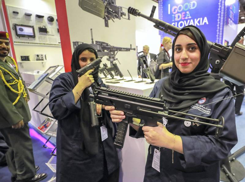 Abu Dhabi, U.A.E., February 18, 2019. INTERNATIONAL DEFENCE EXHIBITION AND CONFERENCE  2019 (IDEX) Day 2--  Lady visitors check out some firearms at the exhibition. Victor Besa/The National