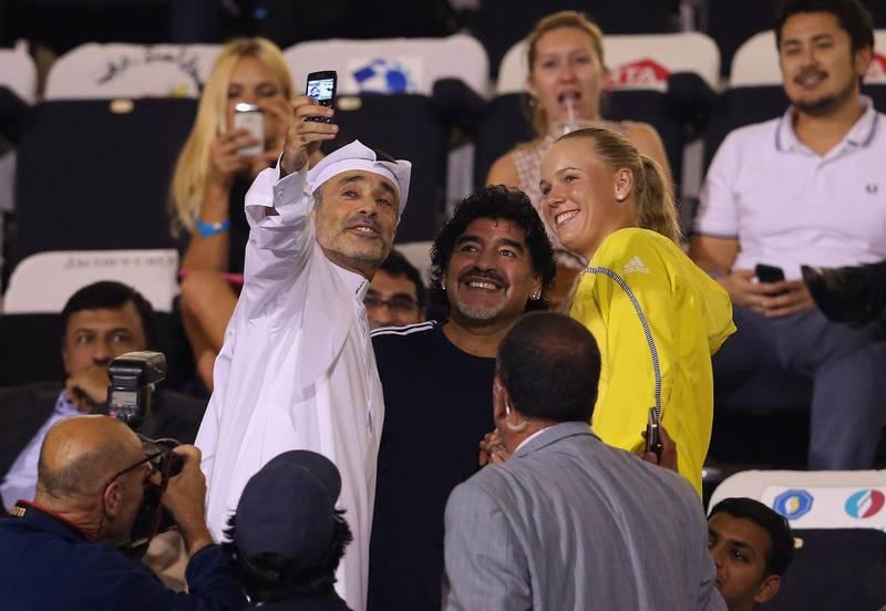 DUBAI, UNITED ARAB EMIRATES - FEBRUARY 20:  Football legend, Diego Maradona meets Caroline Wozniacki of Denmark during day three of the WTA Dubai Duty Free Tennis Championship on February 20, 2013 in Dubai, United Arab Emirates.  (Photo by Julian Finney/Getty Images) *** Local Caption ***  162205662.jpg