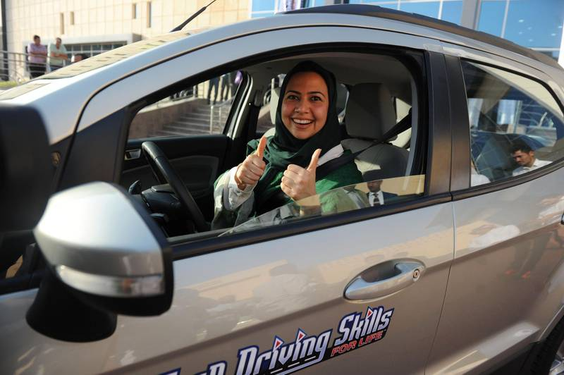 A Saudi woman poses for a photo after having a driving lesson in Jeddah on March 7, 2018. Saudi Arabia's historic decision in September 2017 to allow women to drive from June has been cheered inside the kingdom and abroad -- and comes after decades of resistance from female activists, many of whom were jailed for flouting the ban. / AFP PHOTO / Amer HILABI
