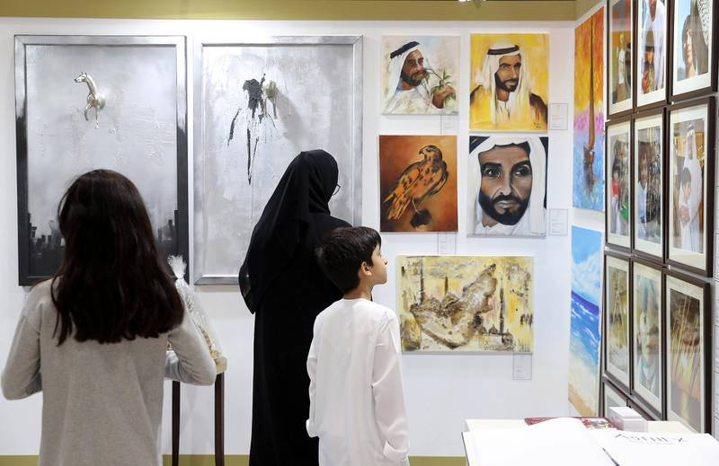 ABU DHABI ,  UNITED ARAB EMIRATES , AUGUST 27 – 2019 :- Visitors looking at the art work at one of the stand during the ADIHEX 2019 held at ADNEC in Abu Dhabi. ( Pawan Singh / The National ) For News/Online/Instagram/Big Picture. Story by Daniel