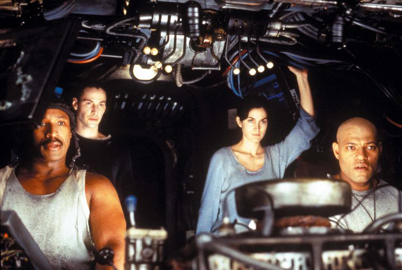 Keanu Reeves, Laurence Fishburne, Carrie-Anne Moss and Anthony Ray Parker in The Matrix. Courtesy Warner Bros.