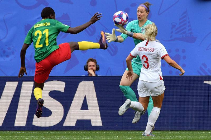 England's goalkeeper Karen Bardsley (C) vies with Cameroon's forward Alexandra Takounda (L) during the France 2019 Women's World Cup round of sixteen football match between England and Cameroon, on June 23, 2019, at the Hainaut stadium in Valenciennes, northern France. (Photo by Philippe HUGUEN / AFP)