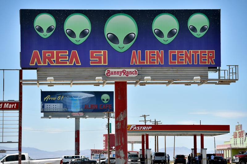 """AMARGOSA VALLEY, NEVADA - JULY 21: A billboard advertising for a convenience store named the Area 51 Alien Center is seen along U.S. highway 95 on July 21, 2019 in Amargosa Valley, Nevada. A Facebook event entitled, """"Storm Area 51, They Can't Stop All of Us,"""" which the author meant as a joke, suggested the attendees to meet up at this colorful tourist attraction before storming the highly classified U.S. Air Force facility on September 20, 2019, to address a conspiracy theory that the U.S. government is conducting tests with space aliens.   David Becker/Getty Images/AFP"""