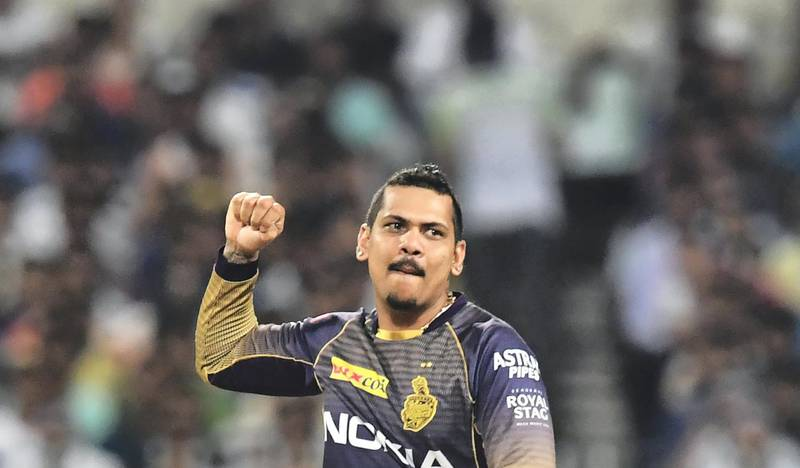 Kolkata Knight Riders's cricketer Sunil Narine celebrates after taking the wicket of Rajasthan Royals' cricketer Ajinkya Rahane during the 2019 Indian Premier League (IPL) Twenty 20 cricket match between Kolkata Knight Riders and Rajasthan Royals at the Eden Gardens Cricket Stadium, in Kolkata, on April 25, 2019. (Photo by DIBYANGSHU SARKAR / AFP) / IMAGE RESTRICTED TO EDITORIAL USE - STRICTLY NO COMMERCIAL USE
