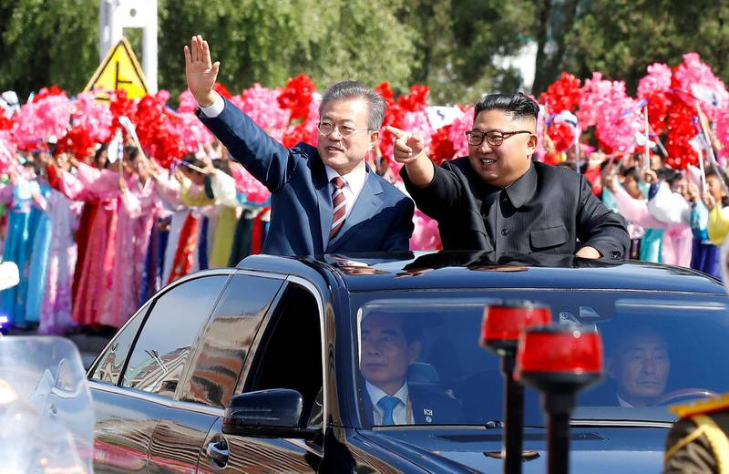South Korean President Moon Jae-in and North Korean leader Kim Jong Un wave during a car parade in Pyongyang, North Korea, September 18, 2018. Pyeongyang Press Corps/Pool via REUTERS      TPX IMAGES OF THE DAY