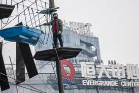 Evergrande shares rise as developer resumes work on stalled projects