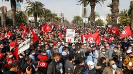 Tunisia's Ennahda party rallies supporters as political row grows