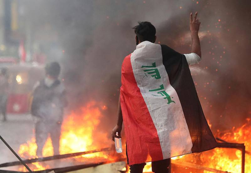 Anti-government protesters set fire and close streets during ongoing protests in Baghdad, Iraq, in central Baghdad, Iraq, Saturday, Nov. 9, 2019. Mass protests erupted in Baghdad and across southern Iraq last month, calling for the overhaul of the political system established after the 2003 U.S.-led invasion.  (AP Photo/Hadi Mizban)
